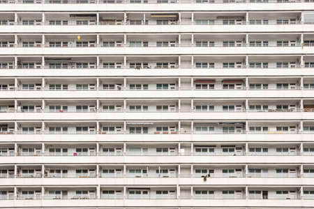 cramped: monotonous facade of an apartment block in Berlin with many balconies