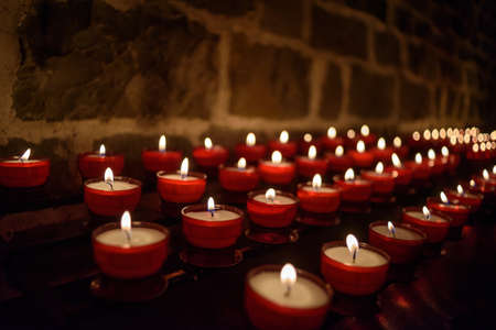 votive: Votive candles burning in a church