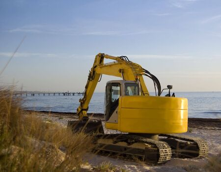motor hoe: sand moving machinery on beach Stock Photo