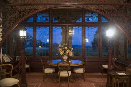 sumptuous: interior of historic mansion with large windows Stock Photo