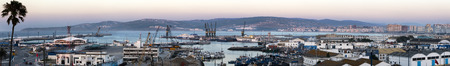 Panoramic view of Tangier Morocco city skyline and port at dusk photo