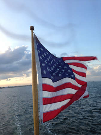 American Flag waving in a breeze above the ocean.  Reklamní fotografie