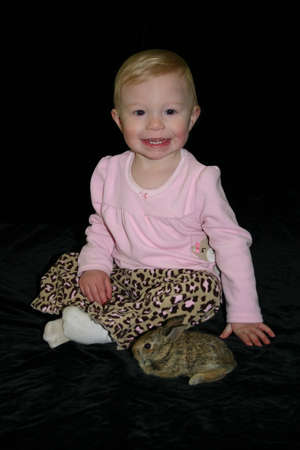 Baby   Toddler with baby bunny rabbit photo