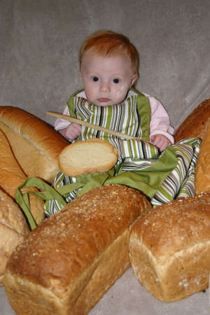 Baby surrounded with baked bread