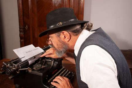 Journalist typing on machine
