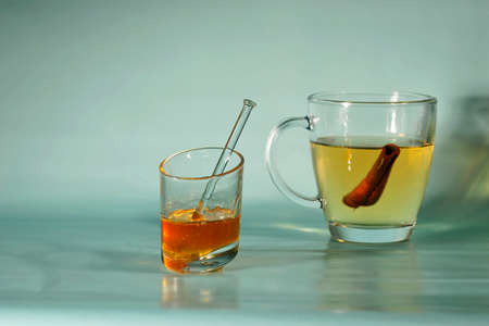 glass of hot tea with on plain background