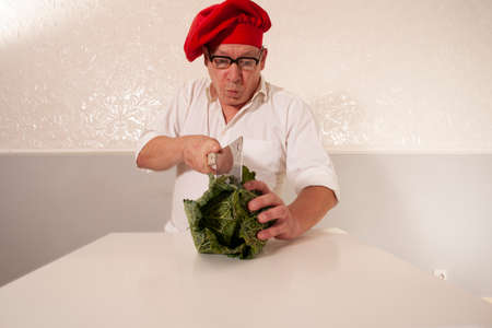 funny chef with vegetables at table