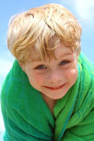 Happy Boy in Beach Towel photo
