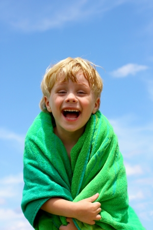 hair wrapped up: Laughing Child Wrapped in green Towel