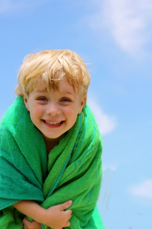 Super Cute and Happy Child in green Towel photo