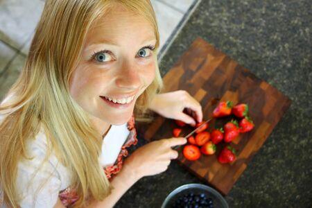 Woman Slicing Strawberries photo