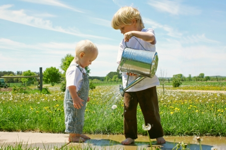 farm boys: Brother Watering Baby