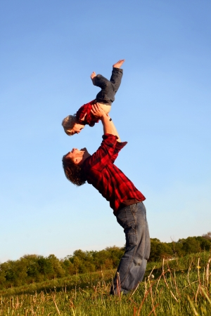Father Lifting Up Son