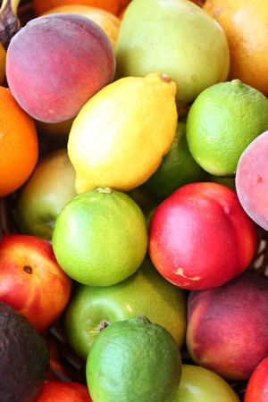 A close up of a pile of a variety of colorful fruit  photo