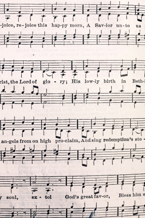 hymn: a yellowed page of music notes and lyrics from an old Lutheran Church Hymnal