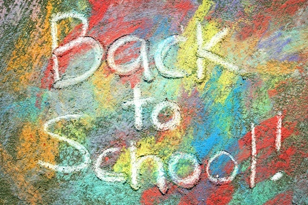 back ground: the words back to school are written in chalkboard Stock Photo