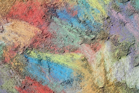 has been: an abstract background of rainbow colored chalk that has been drawn on the sidewalk, leaving grains and colorful dust smudges Stock Photo
