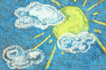 a yellow sun and white clouds are colored on a bright blue sky background with sidewalk chalk