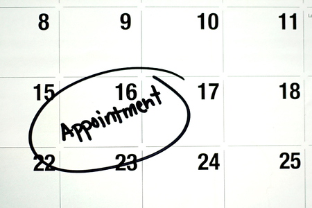 circled: the word appointment is written in black ink and circled on a white montly calendar page