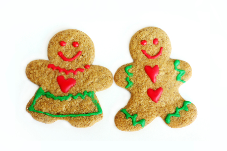 a man and a woman Christmas gingerbread cookie are side by side, isolated on a white background photo