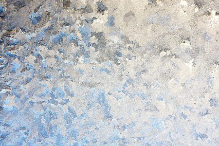 background of a a window in the winter, frosted over with ice, with hints of blue on white.  Room for text, copyspace. photo