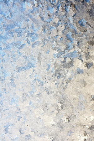 hints: background of a a window in the winter, frosted over with ice, with hints of blue on white.  Room for text, copyspace.