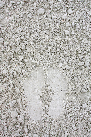 left behind: Two footprints are left behind in the soft white sand. Room for text, copyspace.