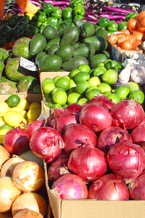 a variety of colorful, fresh fruits and vegetables are displayed on a sale table at a farmer photo