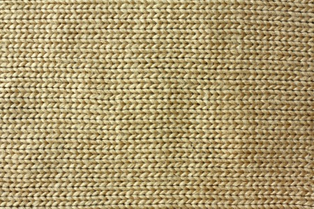 beige:  a background of tweed tan or camel colored knit fabric is braided in lines Stock Photo
