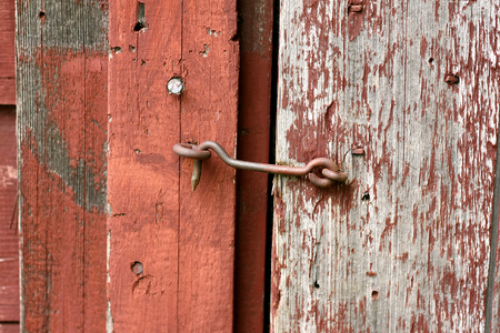 Close Up On An Antique Hook And Eye Latch Lock Old Rustic Red Barn