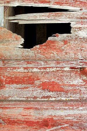 barnwood: Fondo r�stico barnwood edad con gran agujero en la pared del granero.