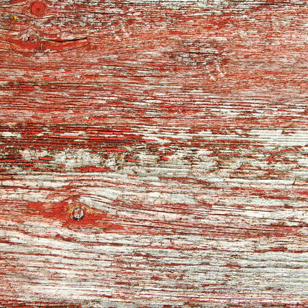 barnwood: A background of rustic, aged barnwood boards, with peeling red paint  Stock Photo