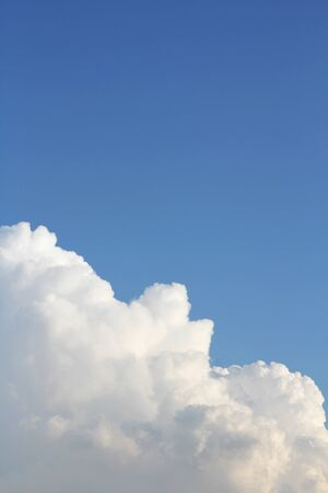 bordering: Cumulus Cloud Bordering Blue Sky Background Stock Photo