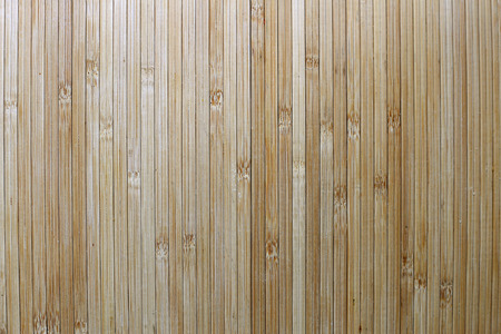 slats: Background with copy-space of Long thin boards of light tan bamboo wood. Stock Photo