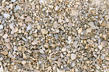 sand quarry: A close up background of rough textured, tan colored crushed gravel screenings. Stock Photo