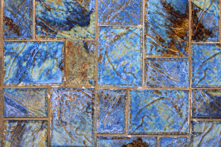 A beautiful blue and gold turquoise mosaic floor tile design background.