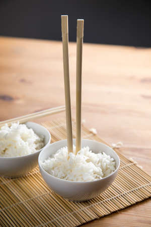Putting chopsticks vertical in rice meaning death in japanese culture Archivio Fotografico