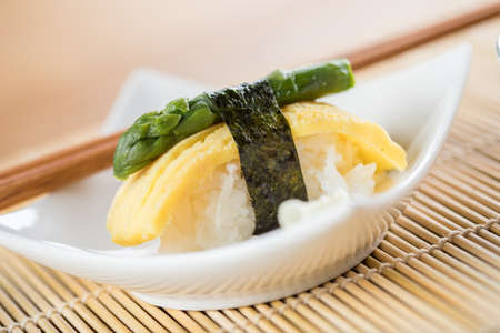 Japanese Tamago omelette nigiri sushi with green asparagus 写真素材