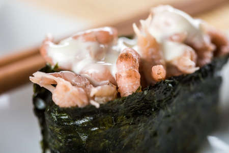 German north sea shrimp in japanese nigiri sushi with wooden chopsticks as appetizer