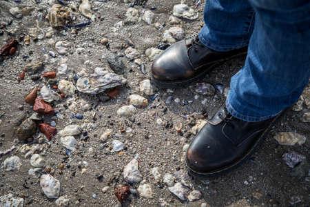 Shoes, stones and rocks during mudflat walking at German north sea beach 版權商用圖片