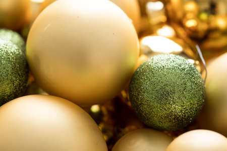Typical German glass Christmas tree decoration, balls and ornaments in gold and green with matt, glitter and shiny finish Stock Photo