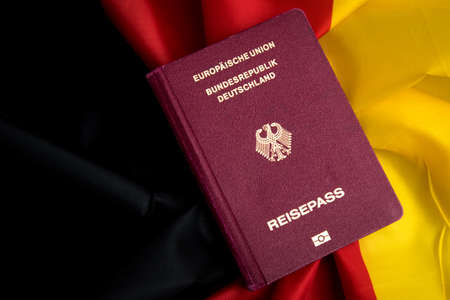 German Passport on flag of federal republic of Germany