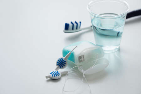 Toothbrush, mouthwash, floss and blue interdental brushes as equipment for daily dental care, prevention and hygiene