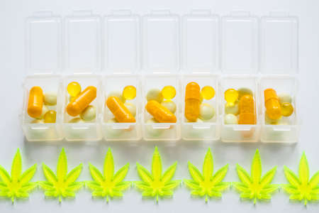 Pills, tablets,  capsules of cannabis marijuana hemp and CBD as pain killer and medical therapy in box dispenser