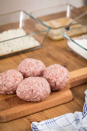 Breaded Scotch Eggs in sausage pork meat and breadcrumbs as party food