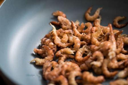 Peeled German Friesland north sea shrimps or crabs in bowl Фото со стока