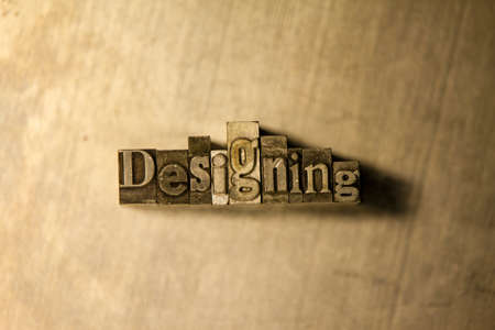 designing: Lead metal Designing typography text on wooden background Stock Photo