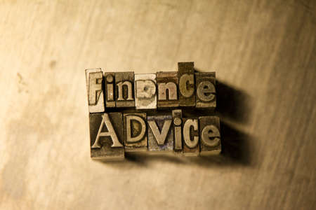 financial advice: Lead metal Finance advice letterpress text on wooden background