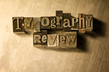 letterpress blocks: Lead metal Typography review type text on wooden background Stock Photo