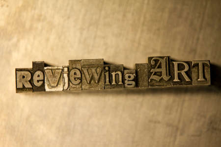 letterpress blocks: Lead metal Reviewing art typography text on wooden background